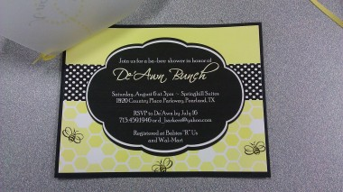 Invitation with vellum cover; option of gold or yellow ribbon